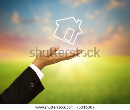 Home on business hand - stock photo