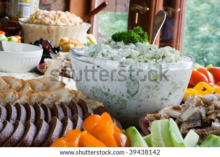 Home party table with various food and dishes - stock photo