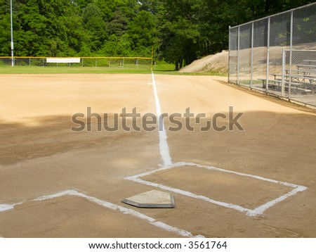 Home plate and first base foul line on a small-town ball diamond - stock photo
