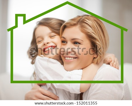home, real estate and family concept - mother and daughter with eco house - stock photo