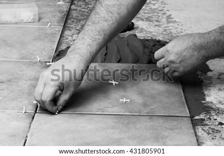 Home , renovation -  tiler is tiling - stock photo
