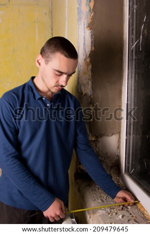 Home repair, installation of the sill, measure the width. construction - stock photo