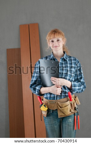 Home repair woman with tools - stock photo