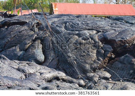 Home ruined by advancing lava in the town of Pahoa, Big Island, Hawaii - stock photo