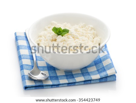 Home rustic fresh fat  curd cheese in a bowl isolated on white background - stock photo
