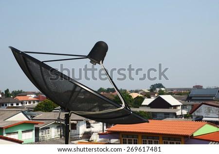Home satellite dish antennas with dusky sky  - stock photo