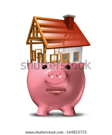 Home savings concept and saving for a house built from a construction project in an open piggy bank as a symbol for a family residence or managing budget funds for renovations on a white background.