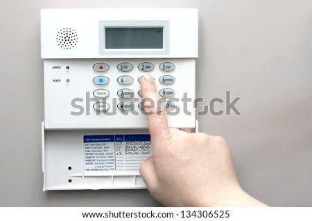 Home security alarm system keypad - stock photo