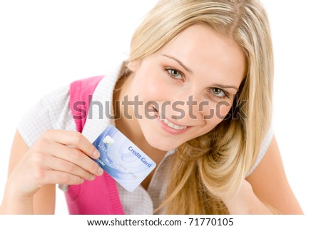 Home shopping - young woman holding credit card on white background - stock photo