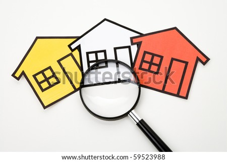 home sign and Magnifying Glass , Real Estate Concept - stock photo