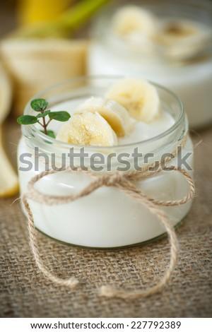 home sweet banana yogurt in a glass jar - stock photo