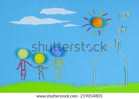 Home sweet home. Figurative family, mother, father and children, holding hands next to a house, on a sunny day