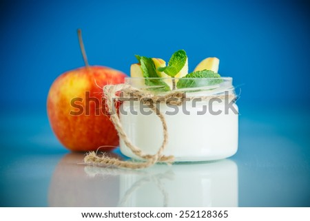 home sweet yogurt with apples on a blue background