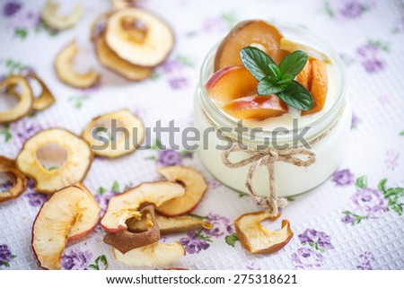 home sweet yogurt with dried fruit cooked in a glass jar - stock photo