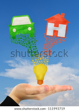 home symbol and car symbol over hand - stock photo
