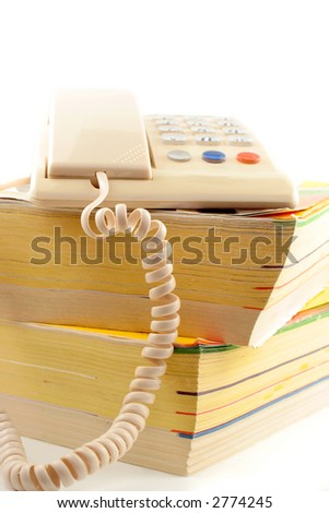 home telephone on top of phone directories - stock photo