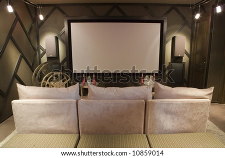 Home theater in a luxury home. - stock photo