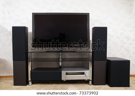 Home theater with plasma tv and hi-fi acoustics - stock photo
