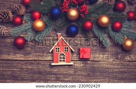 Home toy near pine branches and toys on a table - stock photo