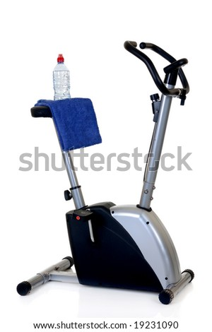 Home-trainer for workout, isolated on white background, reflective surface
