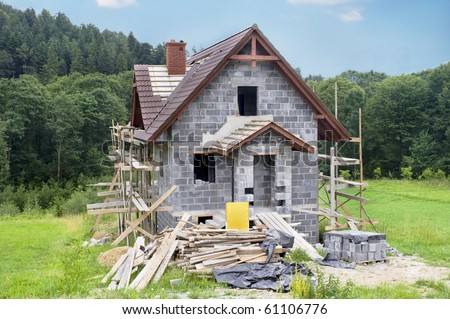 Home under construction - brick house with a beautiful landscape - stock photo