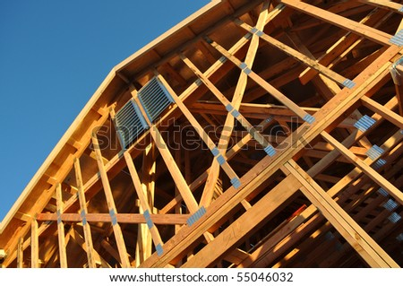 Home Under Construction  Close Up with Blue Sky - stock photo