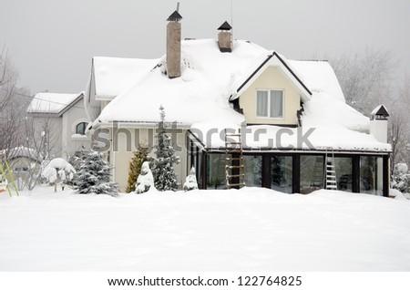 home under snow - stock photo