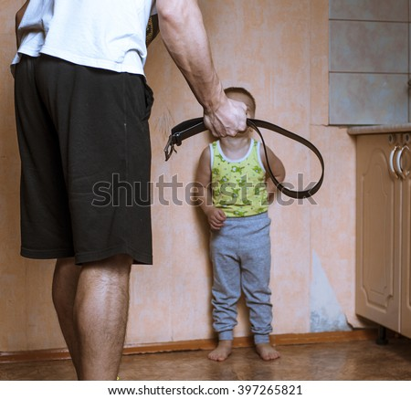 Home violence: Angry father with belt and scared child - stock photo