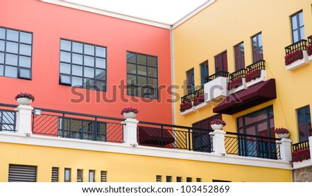 Home wall and windows with flowers. - stock photo