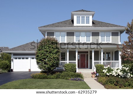 Home with front porch and cedar roof - stock photo