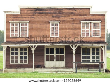 home with green grass in Wild West style - stock photo