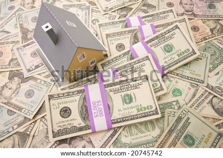 Home with Stacks of Money as Background. - stock photo