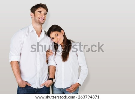 Home. Young couple standing on white background - stock photo