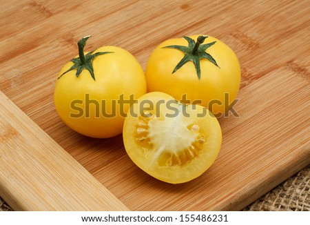 homegrown Yellow tomato harvest from a greenhouse, vegetable produce grown by a keen gardener - stock photo