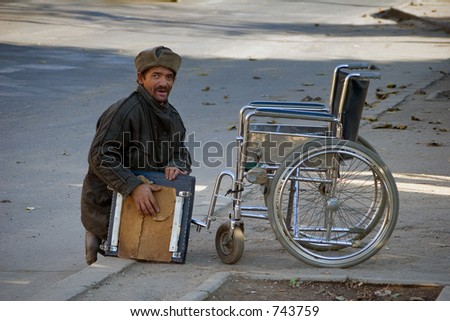Homeless and disabled gypsy person in Romania (2005). - stock photo