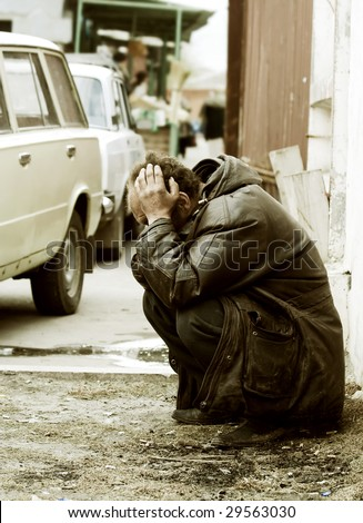 Homeless beggar. - stock photo