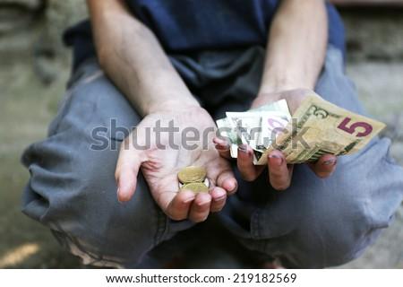 Homeless beggar money  - stock photo