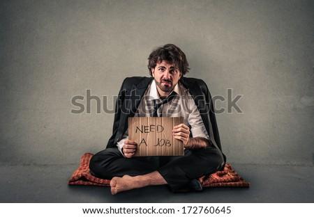 homeless businessman - stock photo