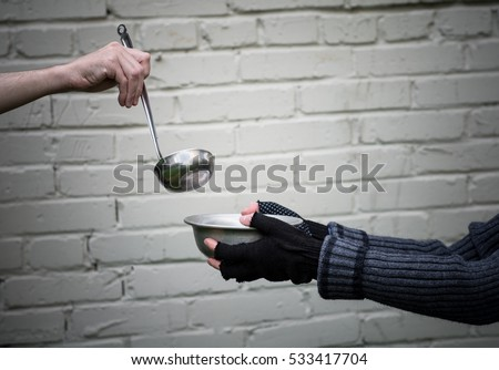 homeless hands one man metal plate stock photo 533417704