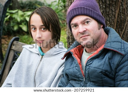 Homeless man and his son.  Family affected by poverty.   - stock photo
