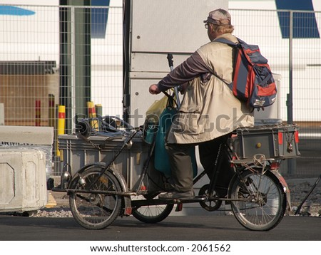 Homeless man on self-made tricycle, close-up - stock photo