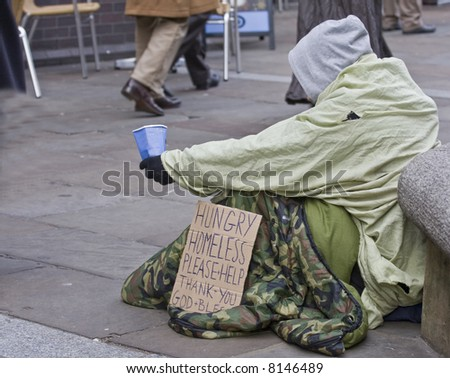 homeless man with sign - stock photo