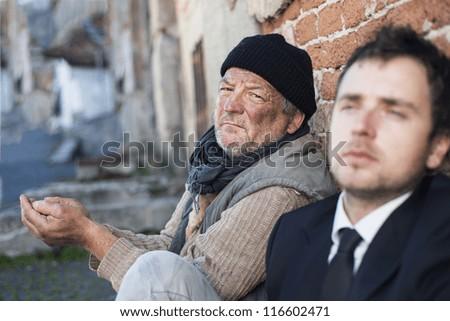 Homeless men are begging on the street. - stock photo