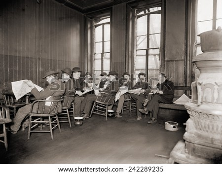 Homeless men in the reading room of a dime a night Bowery lodging house in 1910.