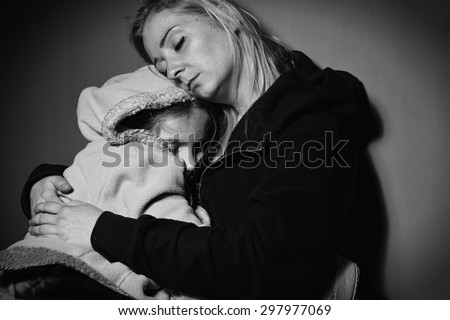 Homeless mother with her daughter. Poor family. MANY OTHER PHOTOS FROM THIS SERIES IN MY PORTFOLIO. - stock photo