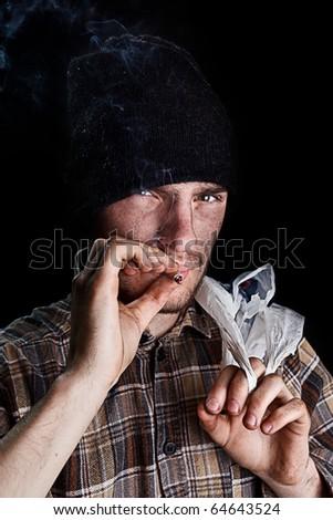 homeless person smoking - stock photo