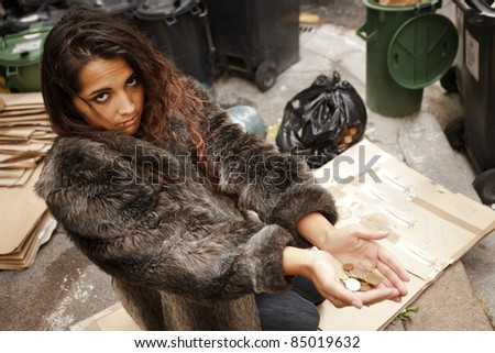 homeless poor woman asking for charity on city pavement - stock photo