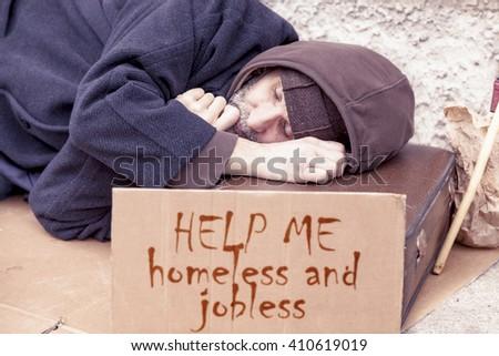 homeless sleeping on a cardboard in landfill - stock photo