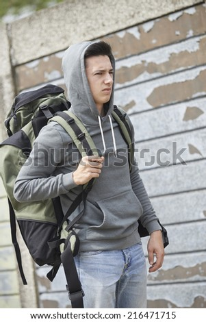 Homeless Teenage Boy On Street With Rucksack - stock photo