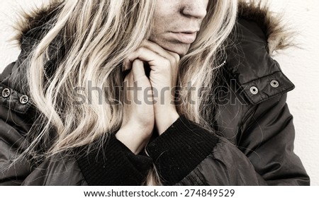 Homeless young woman - stock photo